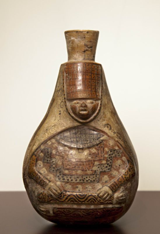 Bottle in the form of a seated dignitary