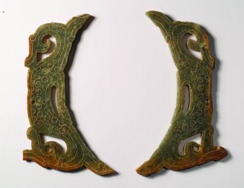 Pair of plaques in the form of dragons