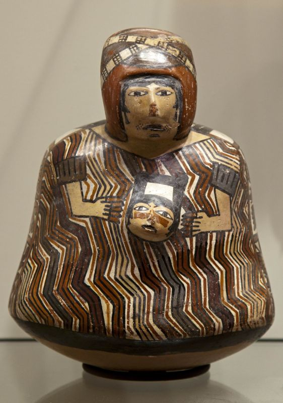 Bottle in the form of a warrior holding a trophy head