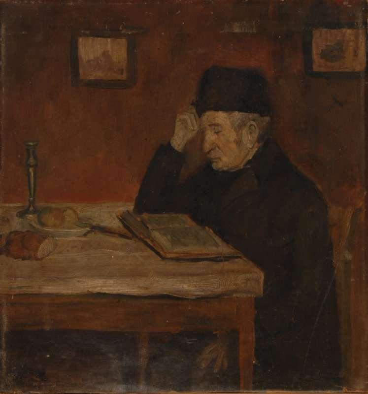 סבא קורא ליד שולחן