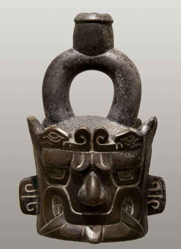Stirrup-spout bottle portraying a deity