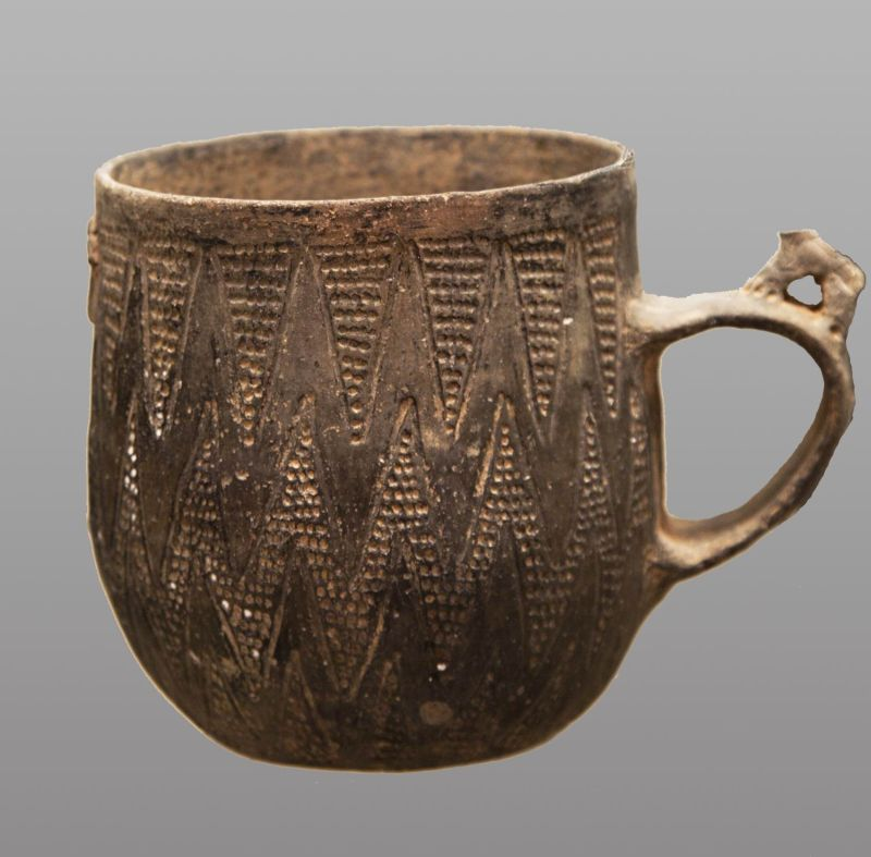 Cup with incised geometric decoration