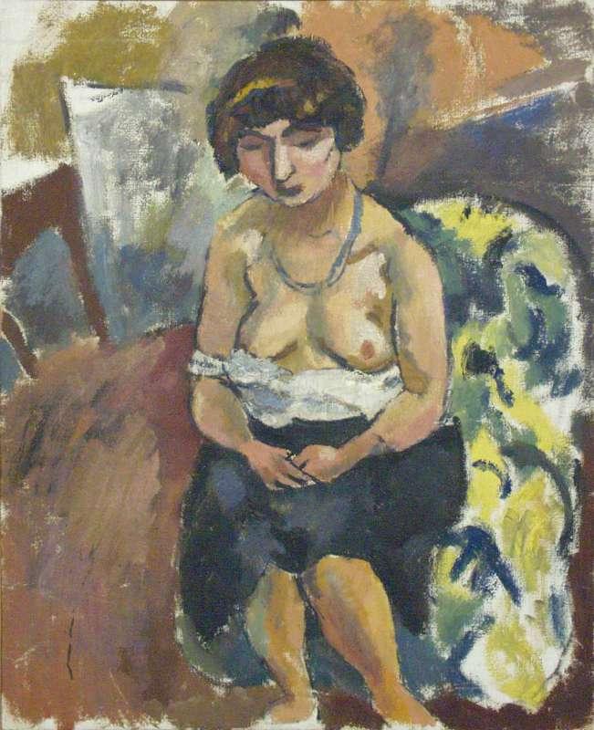 אשה יושבת