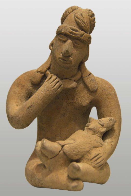Seated mother holding child