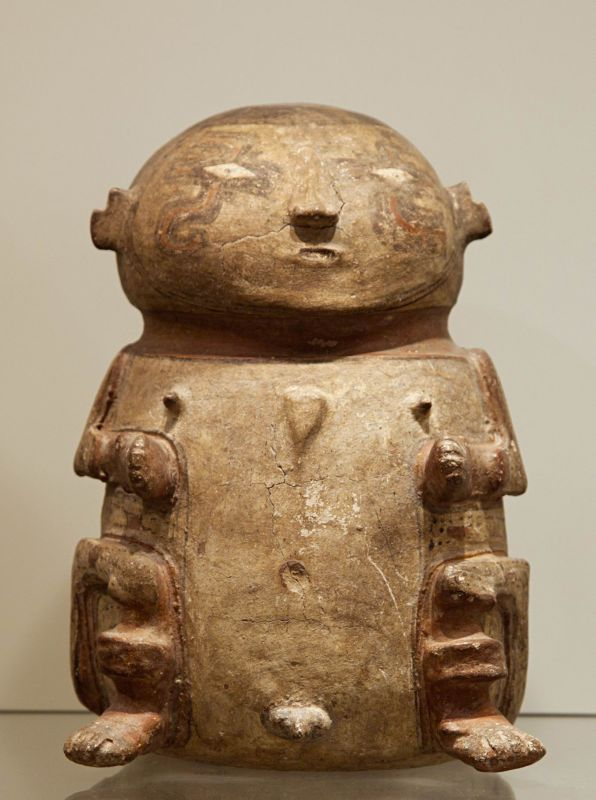 Anthropomorphic lid for funerary urn, with facial and body painting motifs