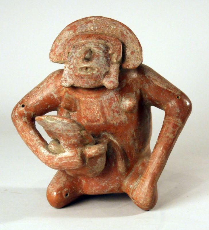 Seated mother holding her child