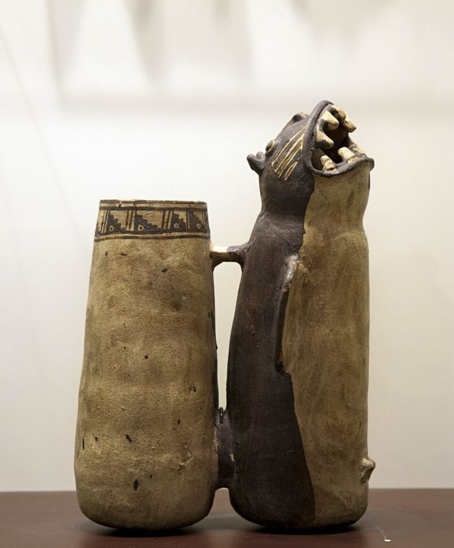 Doubled-bodied whistling bottle in the form of a feline-headed killer whale (<i>orca</i>)