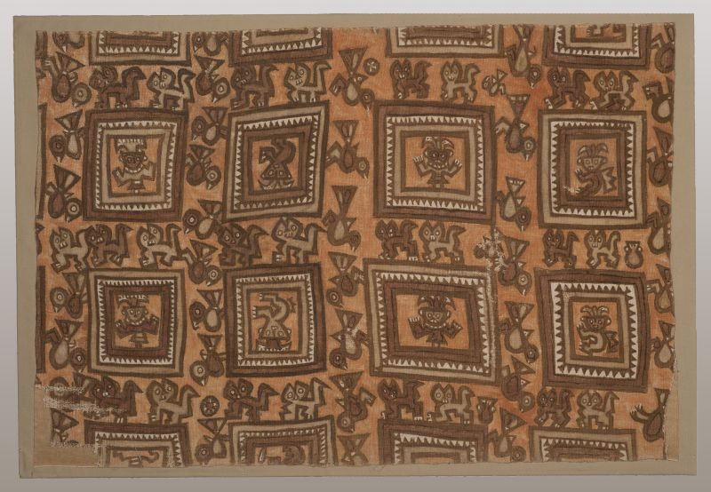 Textile fragment with squares containing figures with upraised arms, interspersed with felines and birds