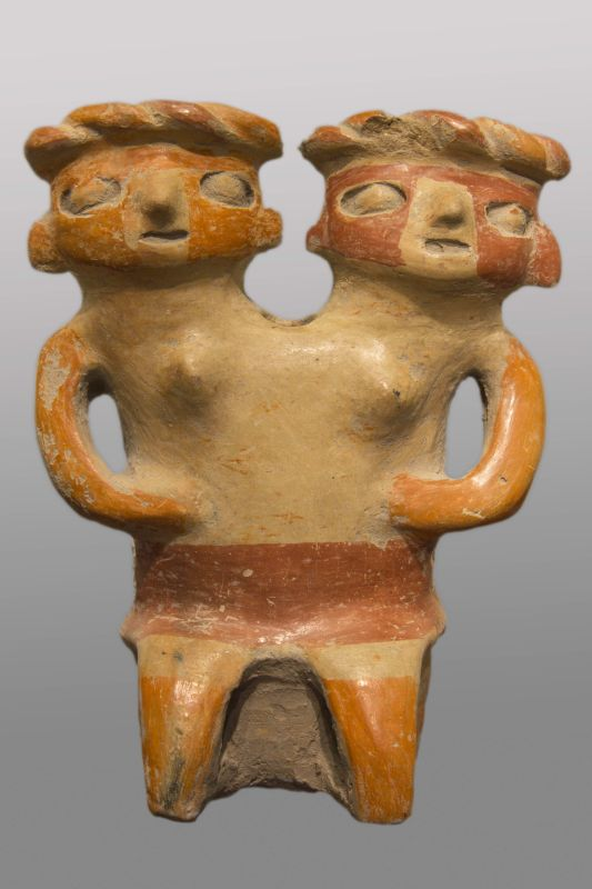 Seated woman with two heads