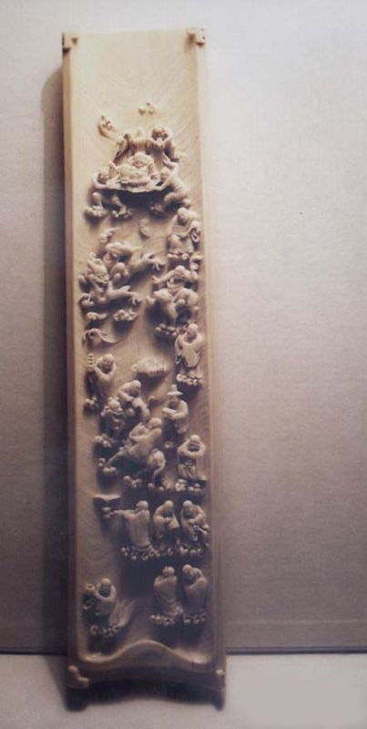 Wrist rest; underside carved with Immortals