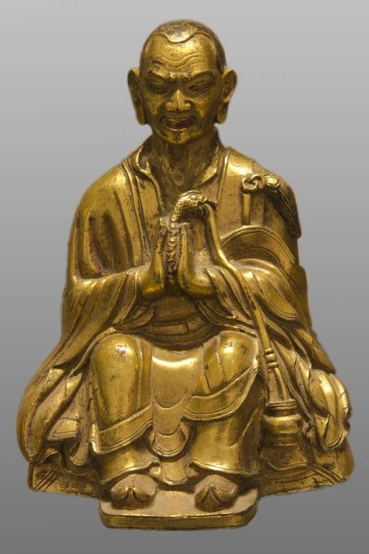 אַרְהַט בָּקוּלָה, תלמיד הבודהה, מחזיק נמייה יורקת אבנים יקרות