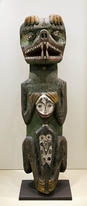 Totem pole with legend of clan's origin