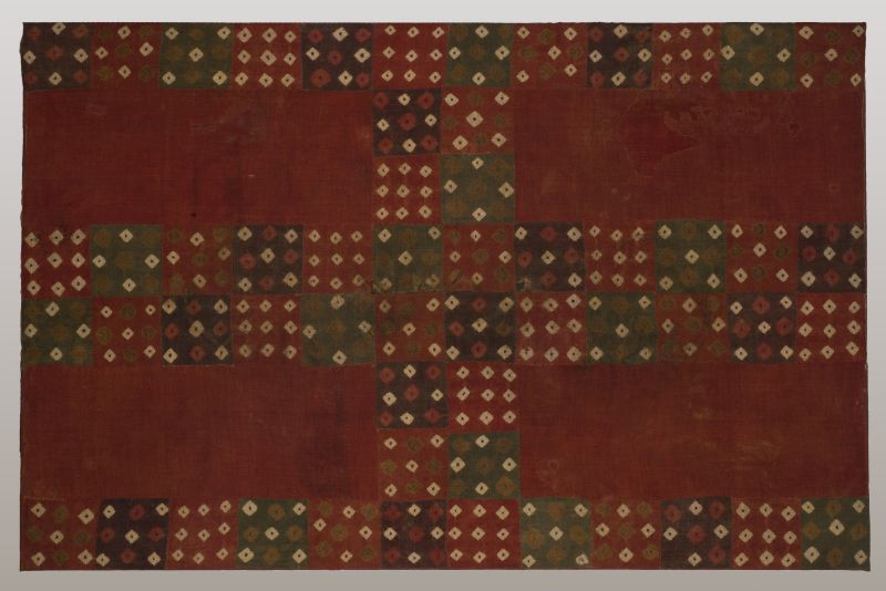 Textile panel with tie-dyed rows of diamond-shaped motifs