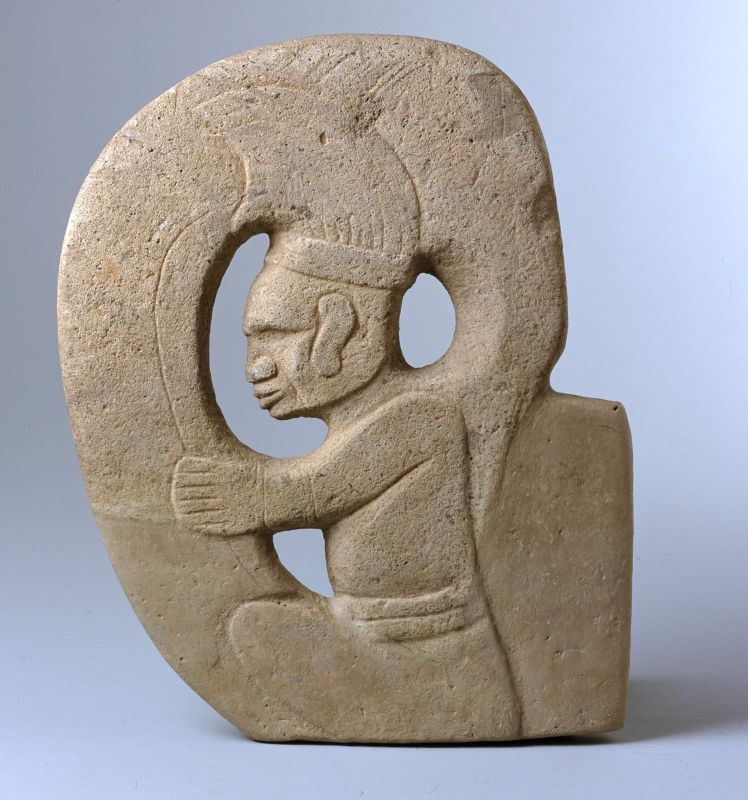 Hacha in the form of a seated captive ballplayer inside a ball court marker/macaw's head