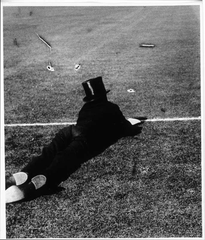 Eton Boy Watching Cricket