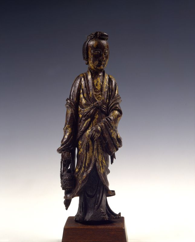 Guanyin, Goddess of Mercy, in the form of Yulan, patron saint of fishermen, carrying a basket with a fish