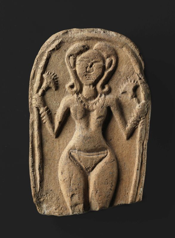 Plaque figurine of a nude goddess adorned with jewelry