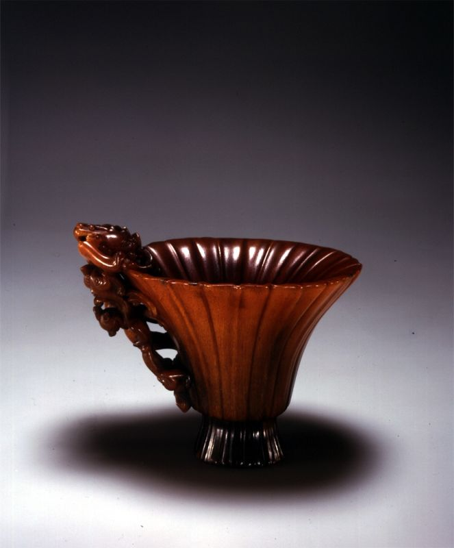Flower-shaped cup with a handle in the form of a dragon