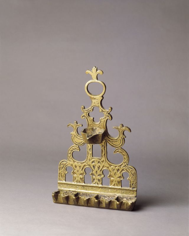 Hanukkah lamp adorned with Moorish gates and fleurs-de-lis