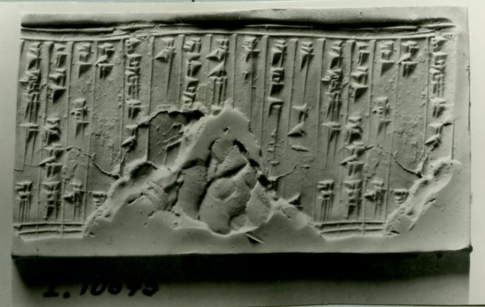 Assyrian cylinder seal inscribed in cuneiform script