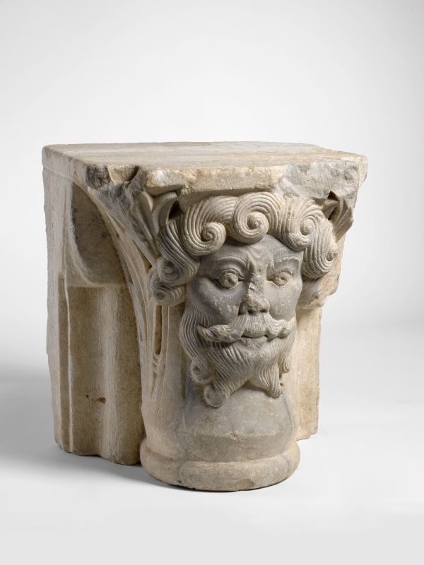 Engaged capital in the shape of the head of a bearded man