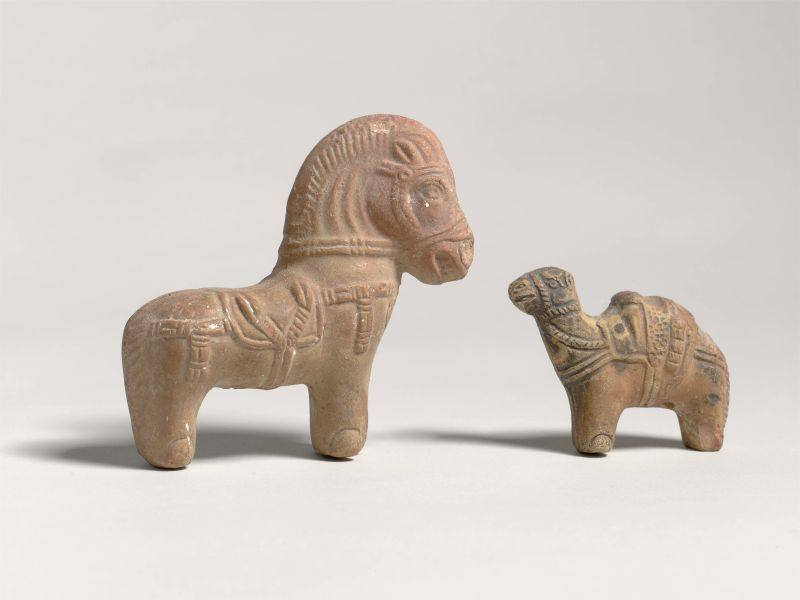 Figurines of a camel and a horse