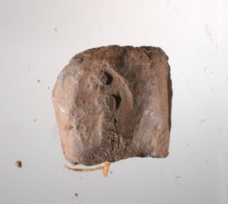 Seal impression (bulla) that sealed an Aramaic papyrus document